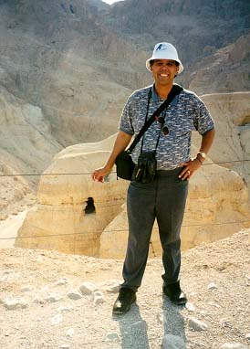 Dr. Hector Avalos at Qumran, Israel, the site near where some of the Dead Sea Scrolls were found. Dr. Avalos teaches all our Bible courses, which place the Bible in the context of ancient civilizations of the Near East. How the biblical texts have been interpreted and adapted throughout history is another focus. His other research areas include health care in the ancient world, science and religion, U.S. Latino Literature, and religion and violence.